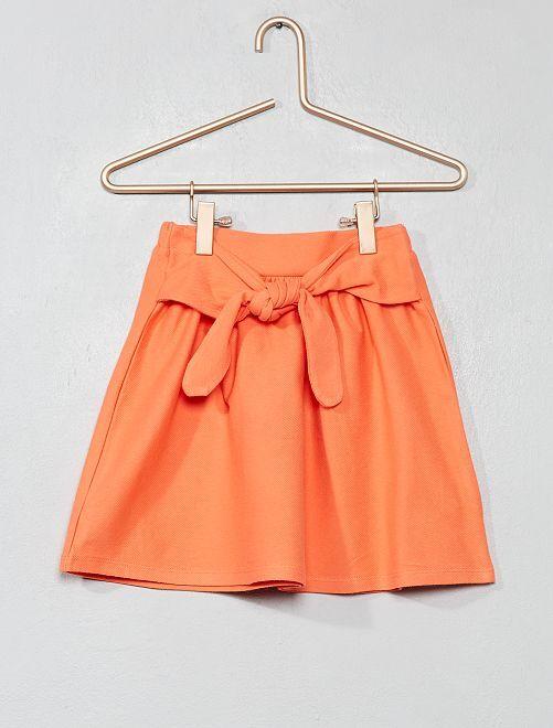 Gonna svasata con fiocco                     arancio corallo Infanzia bambina