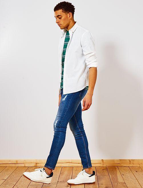 Jeans skinny abrasioni                             BLU Uomo