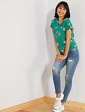 Jeans skinny abrasioni vita molto alta