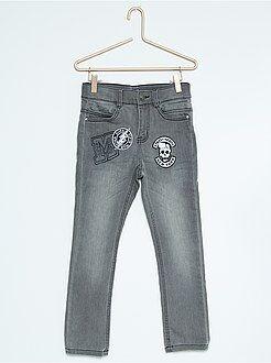Jeans slim con patch