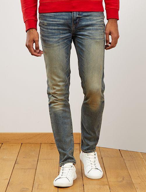 Jeans slim effetto usurato                             BLU