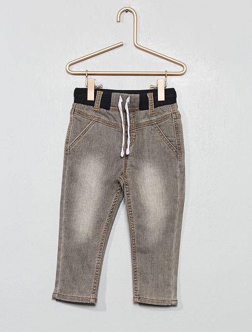 Jeans stretch effetto delavé                             GRIGIO
