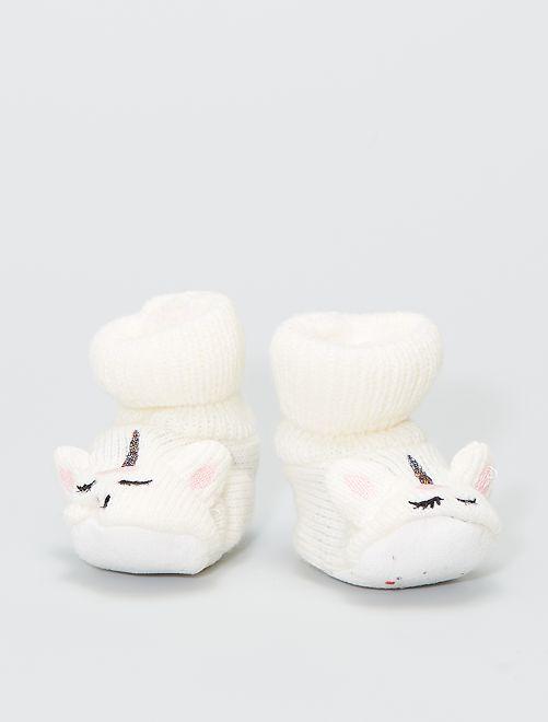 Paio di pantofole in maglia a costine                                         ecru