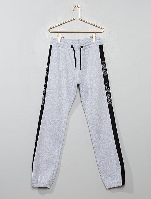 Pantaloni da tuta strisce con messaggi                                         GRIGIO
