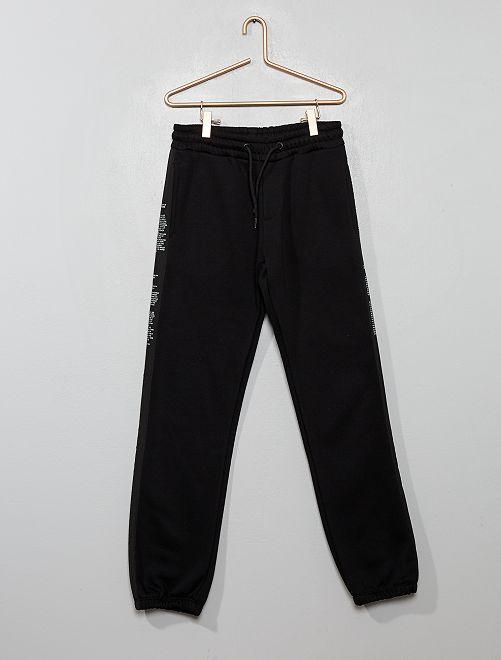 Pantaloni da tuta strisce con messaggi                                         nero