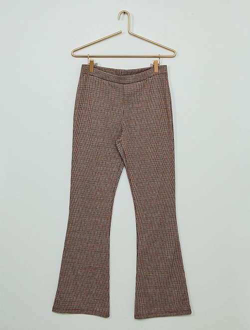 Pantaloni flare pied de poule in maglia punto milano                                         a quadri rosso