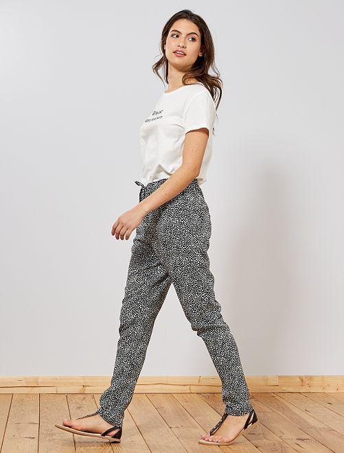Pantaloni fluidi stampati                                             NERO Donna