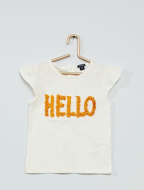T-shirt con scritta in rilievo                                                                 BIANCO