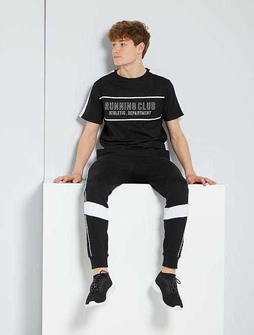 T-shirt con stampa 'running'                             NERO